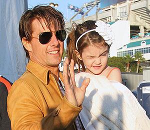 Suri Cruise Gives Dad Fashion Advice