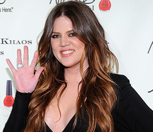 Khloe Kardashian in Dallas Talking Baby and Paternity Rumors