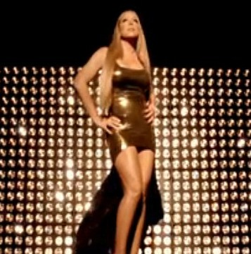 Extra Scoop: Mariah Carey Goes for Gold in 'Triumphant' Video