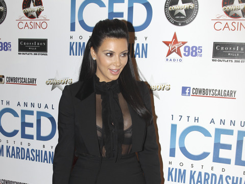 Pregnant Kim Kardashian's Bra Revealed in See-Through Top