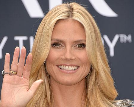 Extra Scoop: Heidi Klum Explains New Ring, 'Not Engaged'