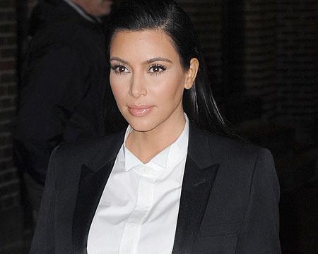 Extra Scoop: Kim Kardashian Slams Paparazzi on Twitter