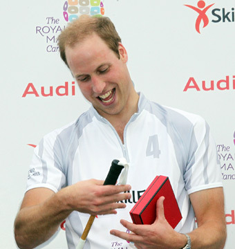 Prince William on Royal Baby: 'He Wriggles a Lot, Keeps Us on Our Toes'