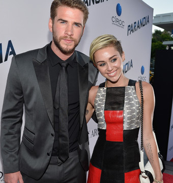 Miley Cyrus and Liam Hemsworth Unafraid to Be Seen at 'Paranoia'