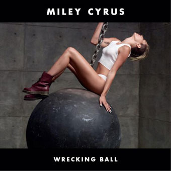 Miley Cyrus Does It Again… Naughty and Nearly Naked on a Wrecking Ball