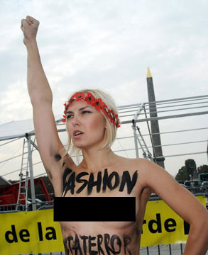 Video! British Model Punches Topless Protester on Catwalk