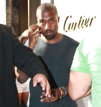 Report: Kanye West to Press Charges Against Paparazzo