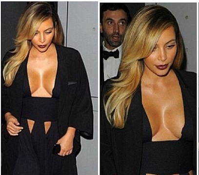 Kim K 'Hangs Out' in Paris, Flashes Cleavage