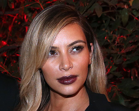 Extra Scoop: Kim Kardashian's Engagement Ring Sells at Auction
