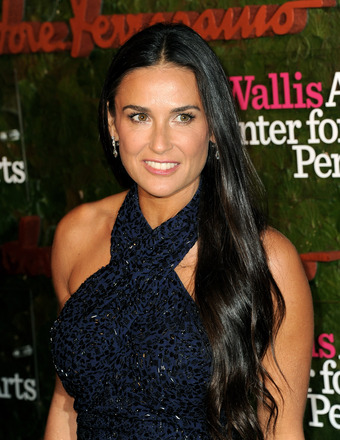 Demi Moore Looks Smokin' Hot in a Bikini, Frolics with Younger Man