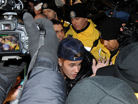 Justin Bieber Turns Himself In to Toronto Police, Media and Fans Swarm
