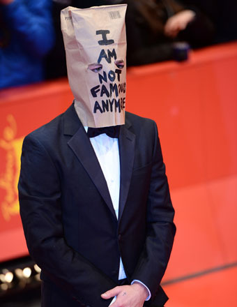 Find Out Why Shia LaBeouf Is Crying and Wearing a Paper Bag Over His Head