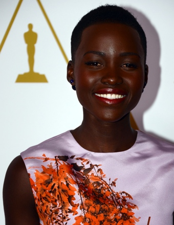 Lupita Nyong'o Dishes on Her Oscars Dress and Meeting Pharrell Williams