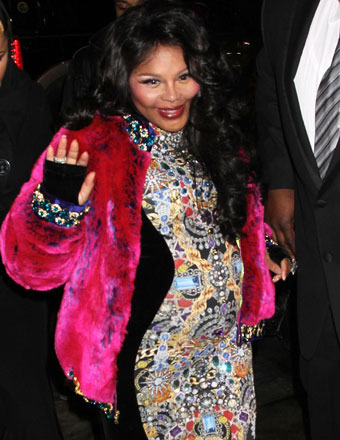 Lil' Kim Debuts Baby Bump at Fashion Week!