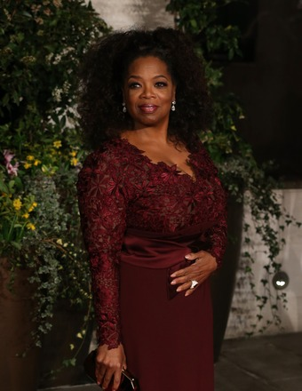 Video! Oprah Winfrey Sews Herself Into Her BAFTA Gown