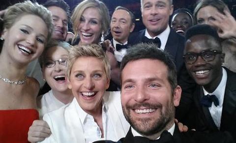 Photobomb! Who Is the Mystery Man in Ellen's Star-Studded Oscar Selfie?