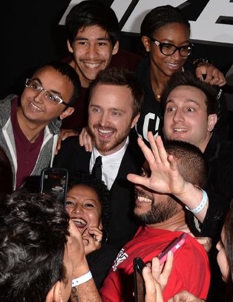 "Aaron Paul posed for pictures with fans at the ""Need for Speed"" premiere in Hollywood."
