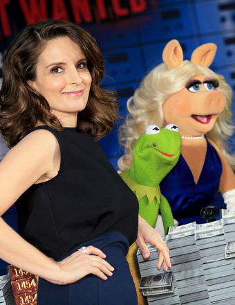 "Tina Fey met up with Constantine and Miss Piggy at the ""Muppets Most Wanted"" premiere in Hollywood."