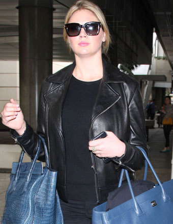 "Kate Upton touched down at LAX after an overseas trip to promote ""The Other Woman."""