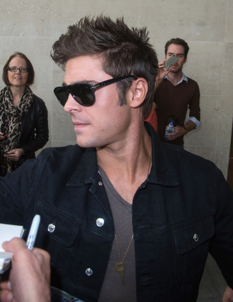 """Neighbors"" star Zac Efron signed autographs for fans outside the BBC Radio One studios in London."