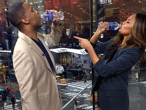 Chrissy Teigen Has a Water Chug Fest with AJ Calloway!