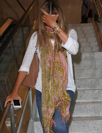 Sofia Vergara hid her face as she arrived to LAX on a flight from New Orleans.