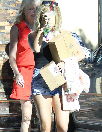 Ashley Tisdale hid her face as she exited her mom's house in Toluca Lake, CA.