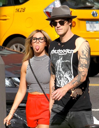 Ashley Tisdale stuck out her tongue at photographers while on a stroll with BF Christopher French.