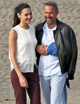 "Kevin Costner wore his arm in a sling while filming ""Criminal"" with Gal Gadot in England."