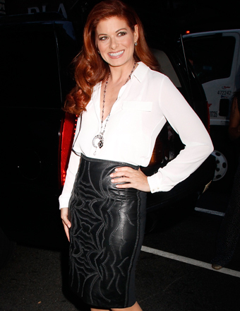 "Debra Messing stuck a pose in a body-hugging black leather skirt and white blouse outside the ""Today"" show in NYC."