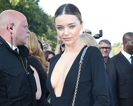 Miranda Kerr and Selena Gomez Pose for Awkward Pic at Paris Fashion Week