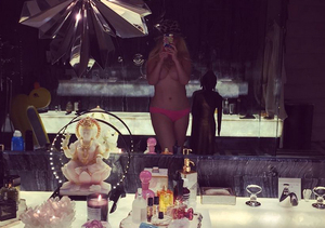Can You Guess the Topless Pop Princess?