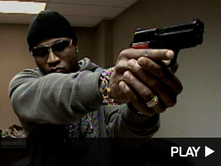 LL Cool J shooting a gun